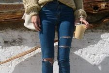 With beige sweater, white bag and lace up high heels