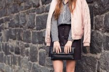 With black and white checked shirt, black button front skirt, clutch and white sneakers