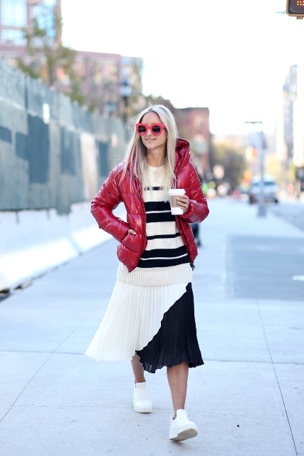 With black and white striped sweater, pleated midi skirt and white sneakers