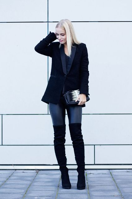 With black blazer, jeans and black and white clutch