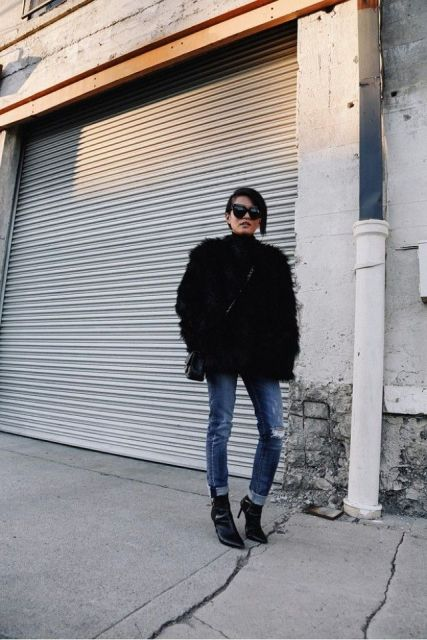 With black faux fur coat, black bag and black ankle boots