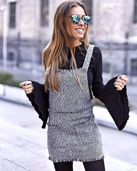 With black flare sleeved shirt and black tights