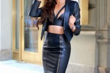 With black leather crop top and oversized sunglasses