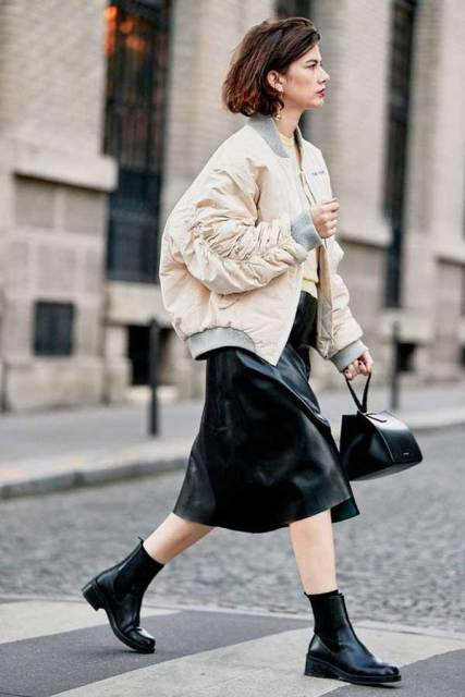With black leather midi skirt, black bag and ankle boots