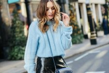 With black leather mini skirt and navy blue mini bag