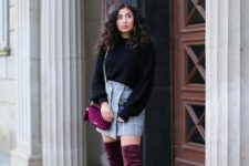 With black loose sweater, checked wrap skirt and marsala bag