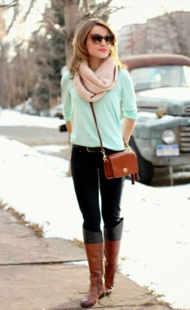 With black pants, beige scarf, brown bag and brown and black high boots