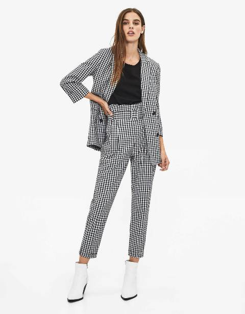 With black shirt, checked blazer and white ankle boots