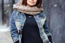 With black shirt, denim jacket, scarf and jeans