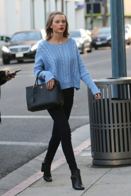 With black skinny pants, black tote bag and high heeled boots