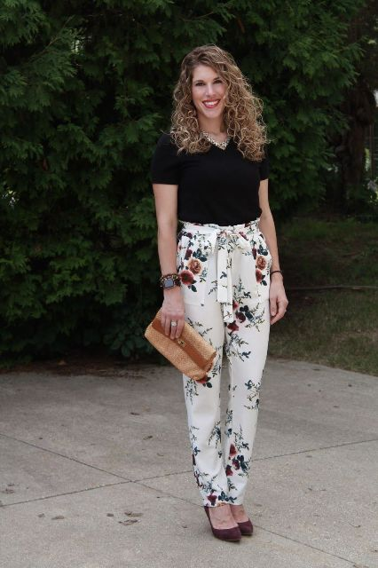 With black t shirt, brown clutch and brown suede pumps