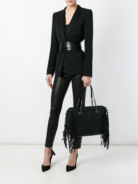 With black top, black blazer, leather belt, leather trousers and black pumps