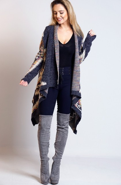 With black top, high-waisted jeans and gray suede platform over the knee boots