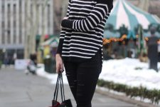 With black trousers, black leather flat shoes and tote bag