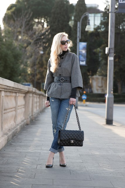 With black turtleneck, black leather chain strap bag, cuffed jeans and black pumps