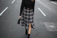 With black turtleneck, checked midi skirt, black bag and boots
