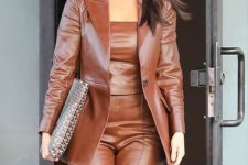 With brown leather top and printed clutch
