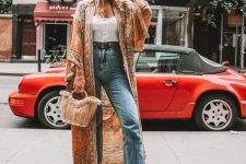 With button down top, high-waisted jeans, beige bag and beige low heeled mules