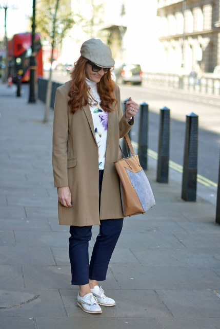 With colorful sweater, brown knee-length coat, navy blue pants, two colored tote bag and white flat shoes