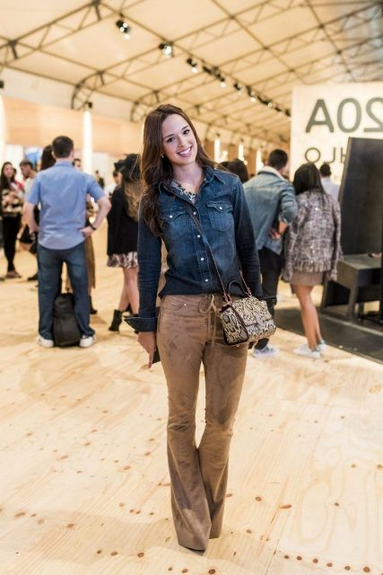 With denim button down shirt, printed bag and shoes