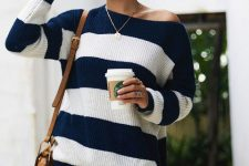With distressed jeans and brown tassel bag