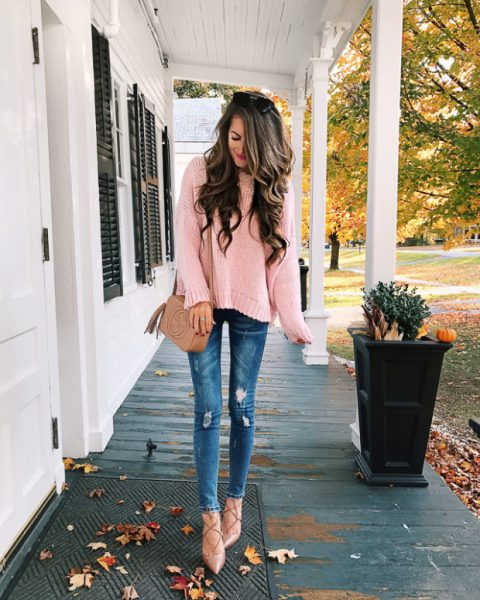 With distressed skinny jeans, brown tassel bag and lace up shoes