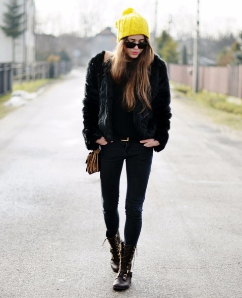 With faux fur jacket, brown bag, skinny pants and lace up boots