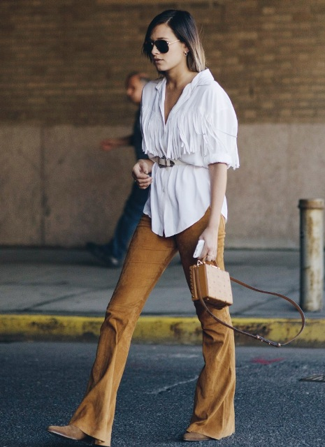 With fringe blouse, belt, brown bag and suede boots