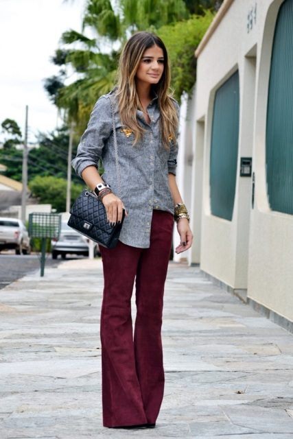 With gray button down shirt, chain strap bag and high heels