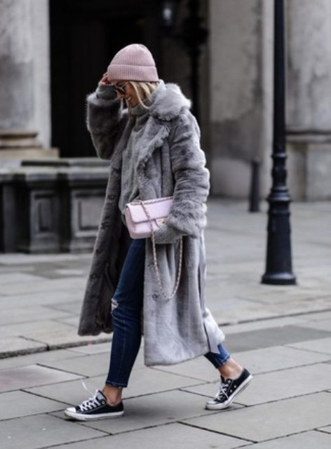 With gray fur coat, distressed jeans, pale pink bag and sneakers