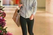 With gray hoodie sweatshirt, tote bag and black leggings