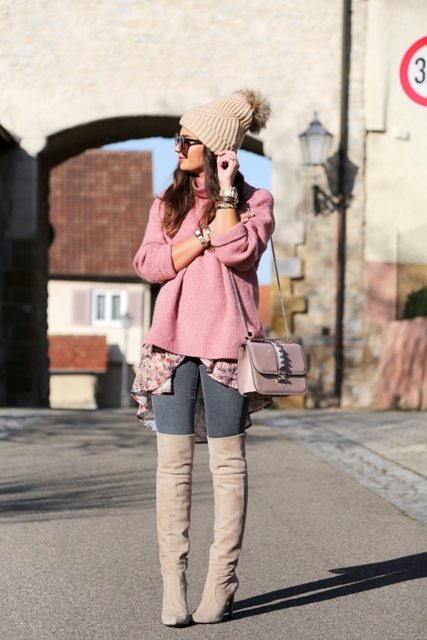 With gray jeans, chain strap bag, pink sweater and gray boots