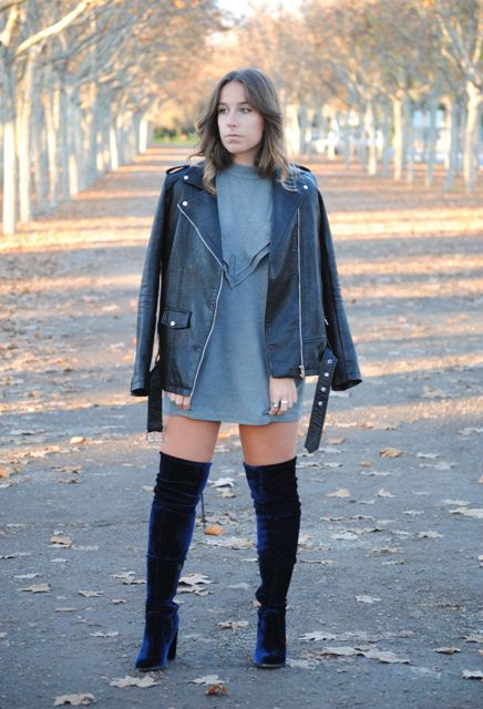 With gray mini dress and black leather jacket