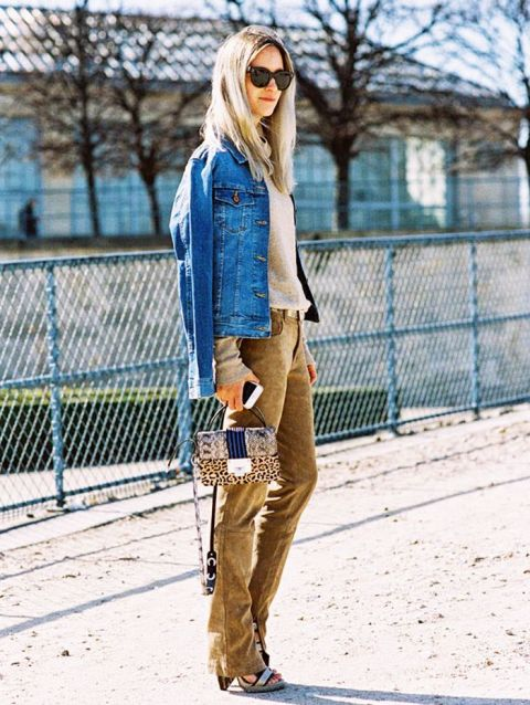 With gray shirt, denim jacket, leopard printed bag and silver high heels