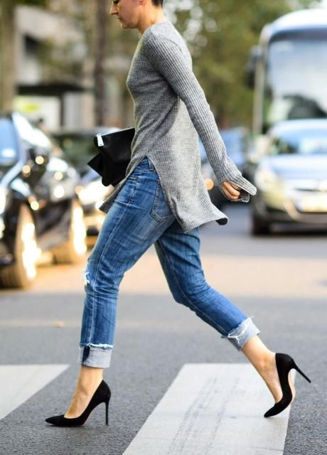 With gray sweater, black clutch and black pumps