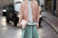 With gray turtleneck, fur clutch, mint green skirt and brown shoes