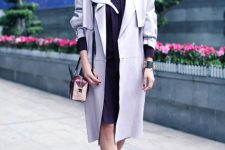 With knee-length dress, three colored bag and cutout boots