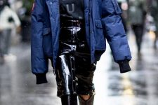 With labeled shirt, black patent leather midi skirt and black high boots