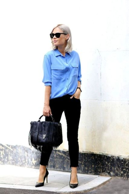 With light blue button down shirt, black skinny pants and black pumps