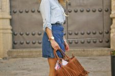 With light blue shirt, denim mini skirt and brown lace up high heels