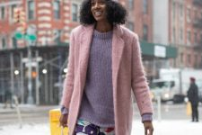 With lilac sweater, colorful pants, mini bag and pink coat