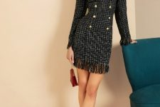 With marsala mini clutch and black suede boots
