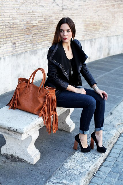 With navy blue cuffed jeans, black suede high heeled shoes and black leather jacket