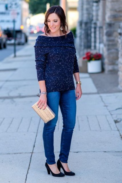 With navy blue jeans, beige clutch and black pumps