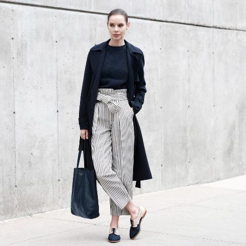 With navy blue shirt, black midi coat, two colored shoes and navy blue leather tote bag