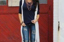 With navy blue shirt, white long vest and brown platform sandals