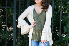 With olive green loose top and cropped jeans