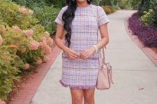 With pale pink bag and beige ankle strap shoes