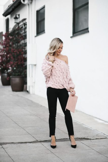 With pale pink clutch, black pants and black pumps
