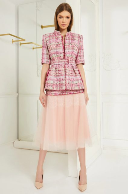 With pale pink midi skirt and beige pumps